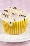 Cupcake with icing and sprinkles Stock Photo