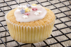 Cupcake with icing and sugar stars Royalty Free Stock Photos