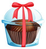 A cupcake inside a container with a red ribbon Royalty Free Stock Images