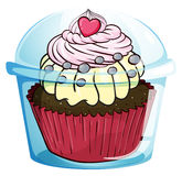 A cupcake inside the disposable cup with a cover Royalty Free Stock Photos