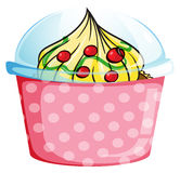 A cupcake inside a dotted pink container Stock Photography