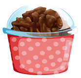 A cupcake inside the pink polkadot container Royalty Free Stock Image