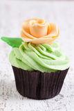 Cupcake with ivory rose Stock Images