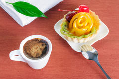 Cupcake with jelly and fruits and a cup of coffee Royalty Free Stock Photo