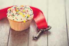 Cupcake and key Royalty Free Stock Image