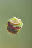 Cupcake. Keylime cupcake floating in space Stock Photography