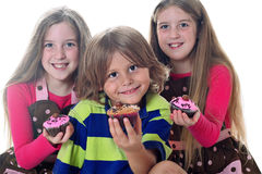 Cupcake kids. Shot of cute cupcake kids isolated on white Stock Image