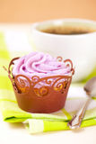 Cupcake with lavender icing top in festive wrap royalty free stock photos