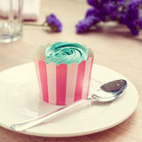 Cupcake and lavender vintage color tone. On table royalty free stock image