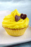 Cupcake with lemon butter cream Royalty Free Stock Photography