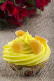 Cupcake with lemon butter cream Royalty Free Stock Images