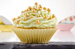 Cupcake with lime butter cream Stock Photos