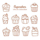 Cupcake line art collection. Sweet baked dessert with cute decoration elements in line art style on white background, vector illustration, doodle sketch Stock Images