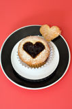 Cupcake with love symbol Royalty Free Stock Photo