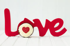 Cupcake love. Cupcake for Valentines day against a white background Royalty Free Stock Image