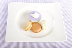 Cupcake and macaroons Stock Photography