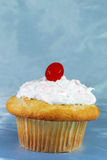 Cupcake with a maraschino on top Royalty Free Stock Images