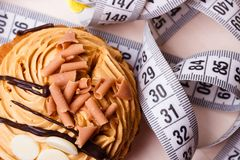 Cupcake with measuring tape on table Royalty Free Stock Image