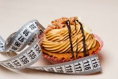 Cupcake with measuring tape on table Stock Images