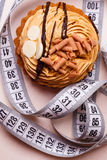 Cupcake with measuring tape on table Royalty Free Stock Photo