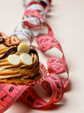 Cupcake with measuring tapes on table Stock Photo