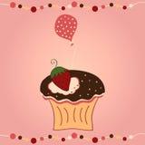 Cupcake met aardbei en ballon Stock Foto