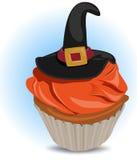 Cupcake met een decoratieve hoed bij bovenkant Royalty-vrije Stock Foto's