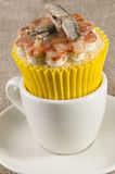 Cupcake with mini anchovy pizza Stock Images