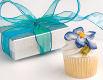 Cupcake Mini Decorated With Gift Box. Mini two bite cupcake with silver gift box and blue bow Royalty Free Stock Image