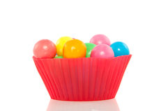 Cupcake mold filled with gumballs Royalty Free Stock Photos