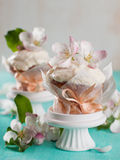 Cupcake or muffin with fresh flower Stock Images