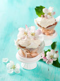 Cupcake or muffin with fresh flower Royalty Free Stock Image