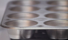 Cupcake or muffin pan, empty, background image Stock Photography