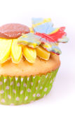 Cupcake with multicolour butterfly Royalty Free Stock Photos