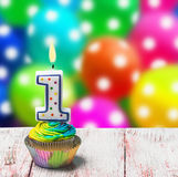 Cupcake with number one on the background of balloons Royalty Free Stock Image