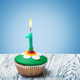 Cupcake with number one on a blue background Royalty Free Stock Photos