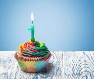 Cupcake with number one. On a blue background. birthday greetings Stock Photography