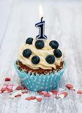 Cupcake with a numeral one candle Stock Photo