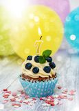 Cupcake with a numeral seven candle Stock Photo