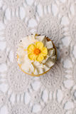 Cupcake on old fashioned doily, with a yellow flower Royalty Free Stock Photos