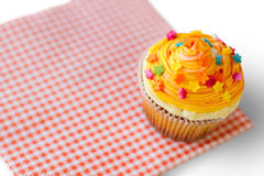 Cupcake with orange icing. Stock Photography