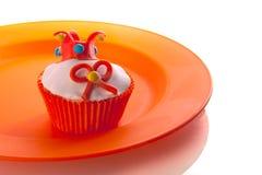 Cupcake. A cupcake on an orange plate ( celebrating the dutch coronation Stock Photos