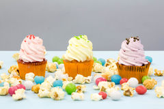Cupcake packaging, delivery box, vanilla cupcakes with pink and white cream, selective focus, close up Royalty Free Stock Photography
