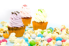 Cupcake packaging, delivery box, vanilla cupcakes with pink and white cream, selective focus, close up Stock Images