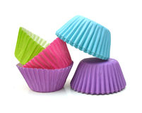 Cupcake paper cups. Colorful cupcake paper cups on white background Royalty Free Stock Photo