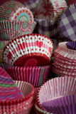 Cupcake papers. Background full of pink, red and purple cupcake papers Royalty Free Stock Photo