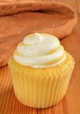 A cupcake with peach filling Stock Photos