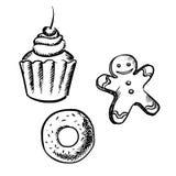 Cupcake, peperkoekmens en doughnutschetsen Stock Foto's