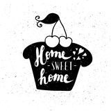 The cupcake with the phrase Sweet home. Royalty Free Stock Images