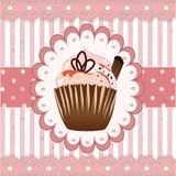 Cupcake on the pink background with cinnamon Royalty Free Stock Image